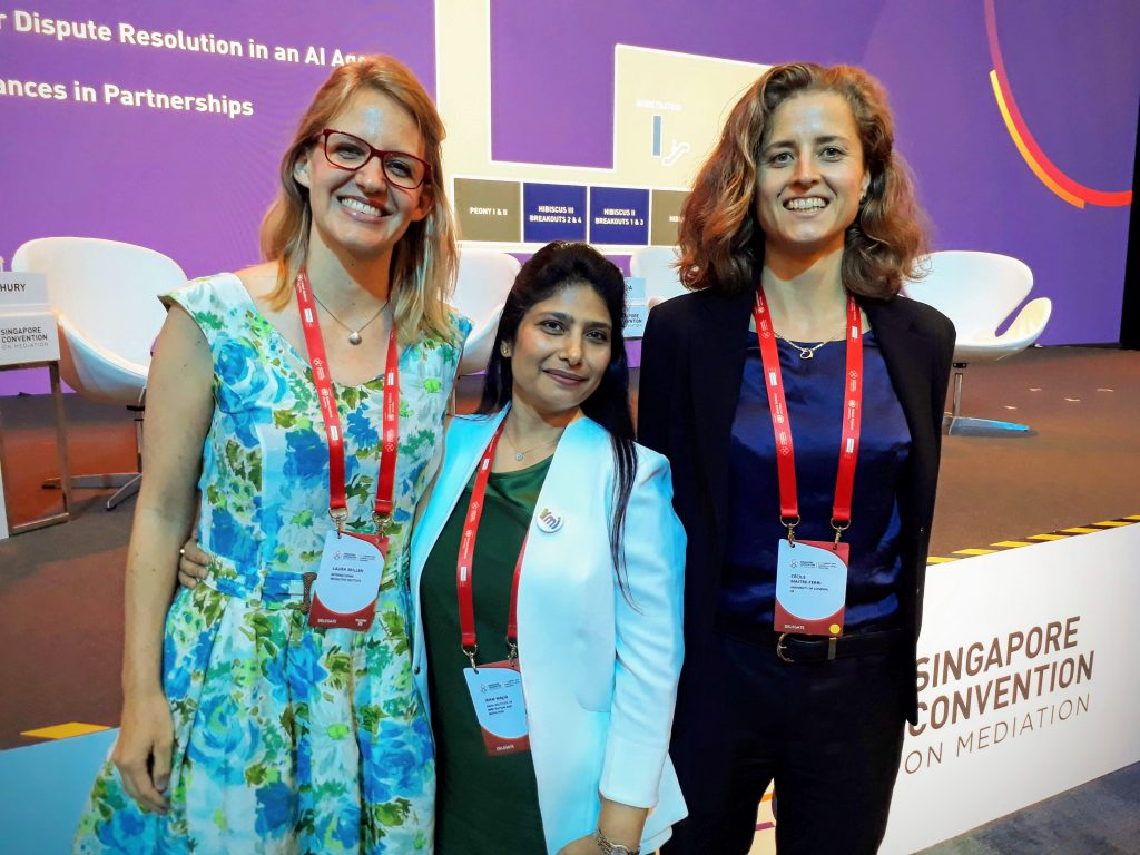 Photo of IMI Executive Director Laura Skillen, YMI member and IMI Certified Mediator Iram, and Cecile.